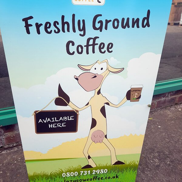 Street sign for Lazy Cow Coffee